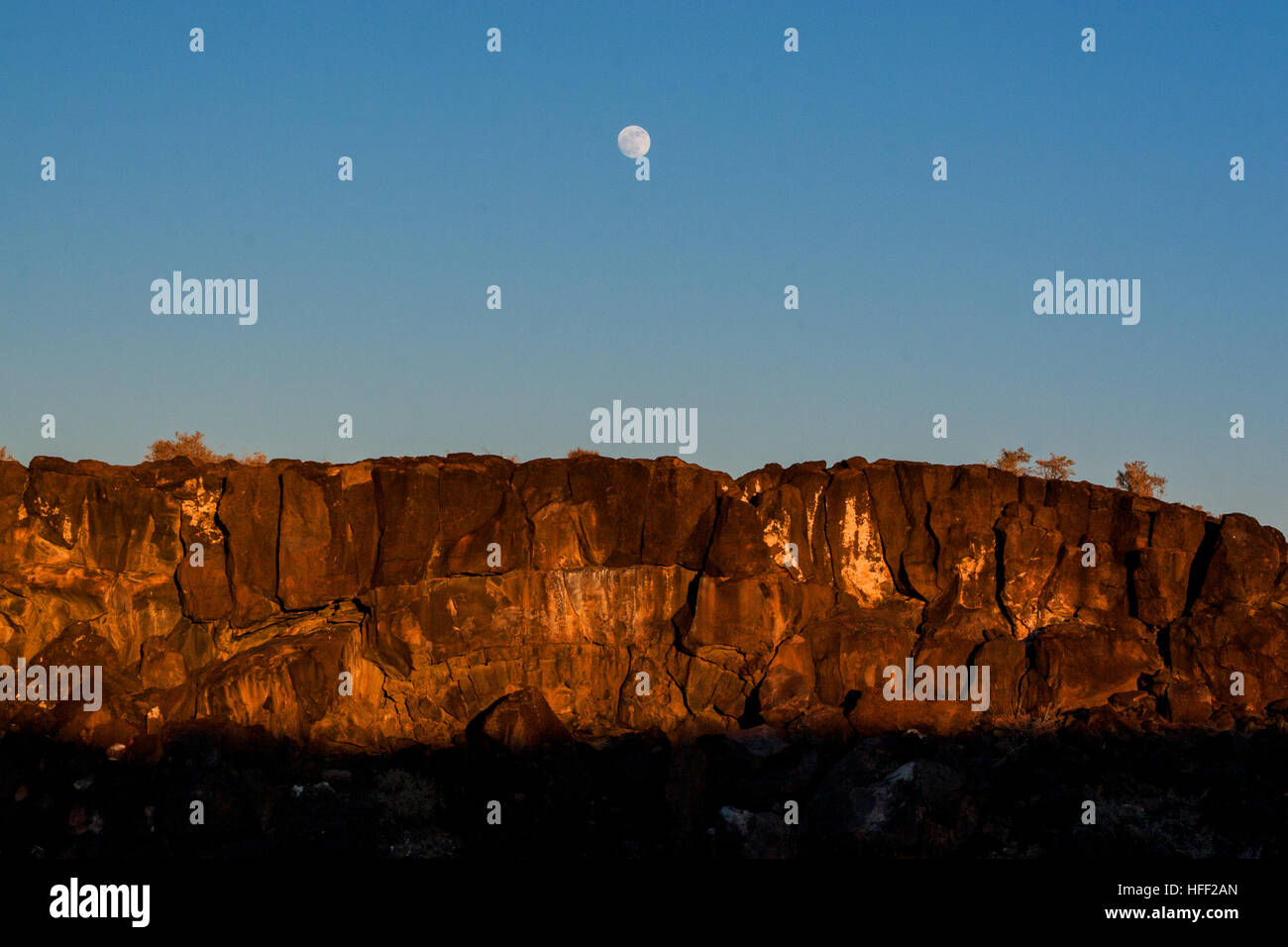 Moonrise over the mesa in Petroglyph National Monument, Albuquerque, New Mexico Stock Photo