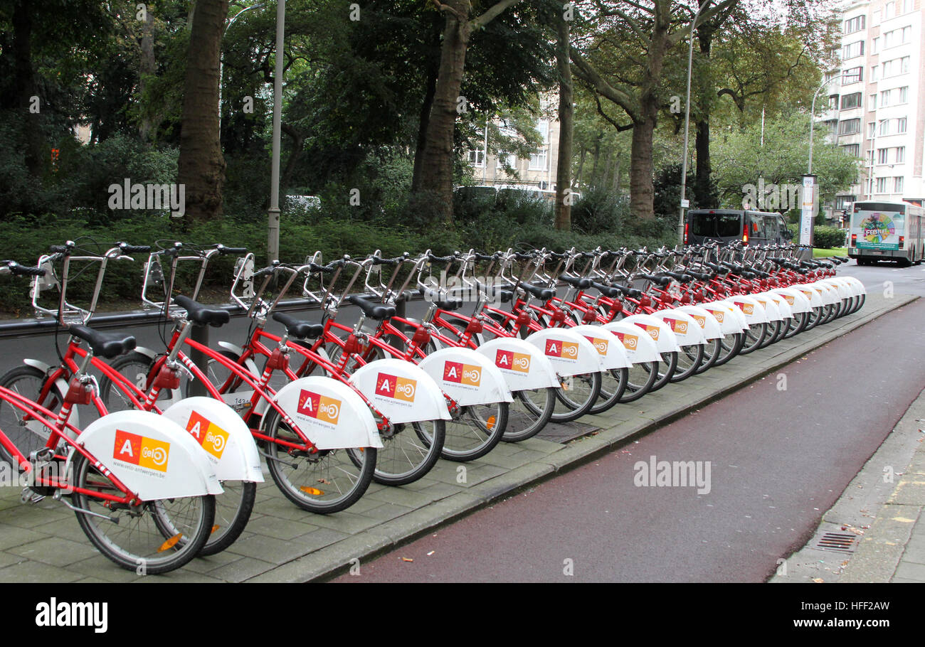 Bicycles lined up for rent in Antwerp Belgium.  This station Velo-station is by the Leopold Hotel. Stock Photo