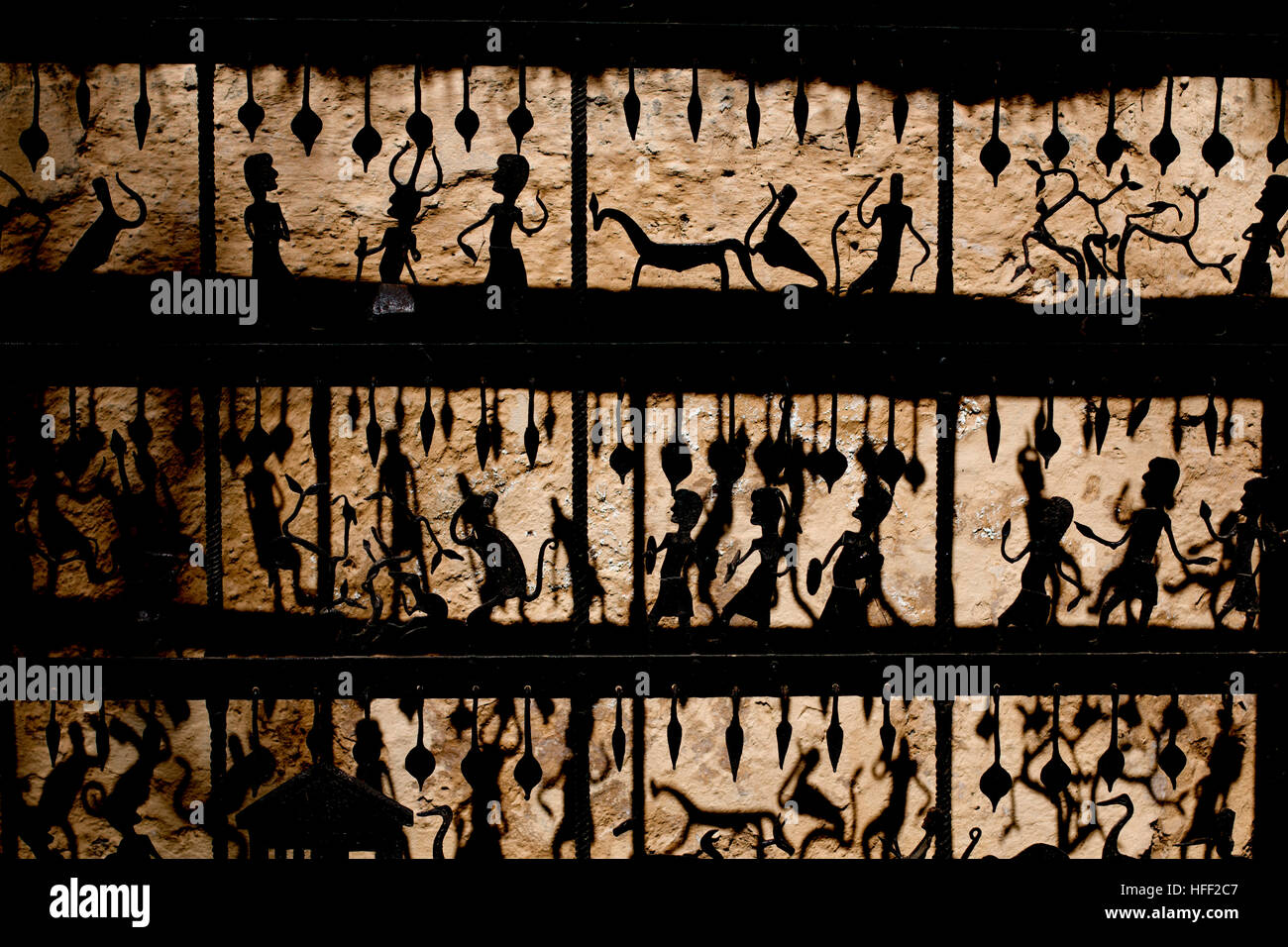 Light and shadow play on a Bastar tribal art piece made of wrought iron - Stock Image