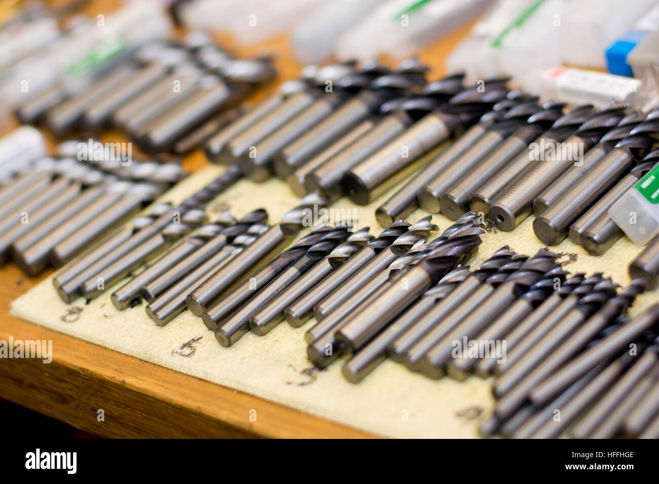 precision engineering tooling chucks on workshop table Stock Photo