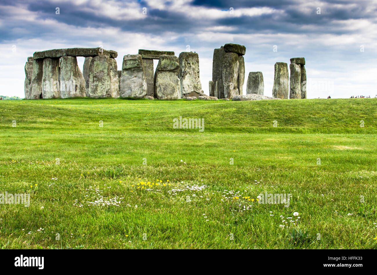 Lush green fields by prehistoric Stonehenge in Salisbury, England - Stock Image