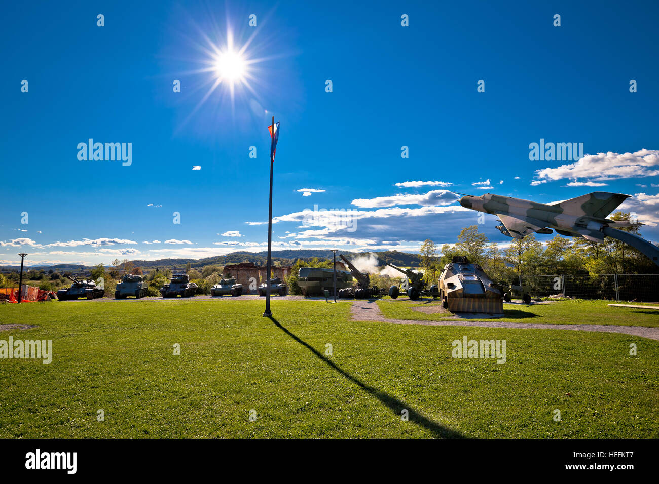 Military tanks and fighter jet with sun rays view, Karlovac, Croatia - Stock Image