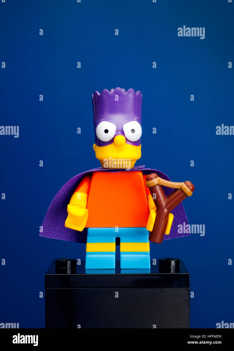 Tambov, Russian Federation - June 08, 2015 Lego Bart Simpson minifigure as a Bartman with slingshot on blue background. - Stock Image