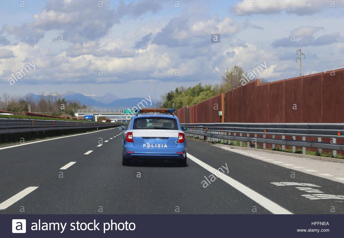 Italian police car patrolling runs fast on the highway - Stock Image