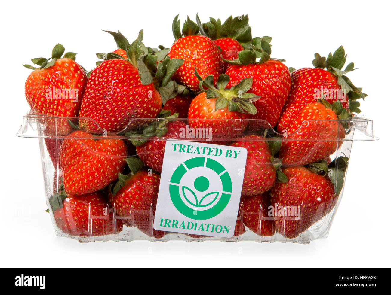 This container of strawberries features a 'Treated by irradiation' label.  According to the US Food and - Stock Image