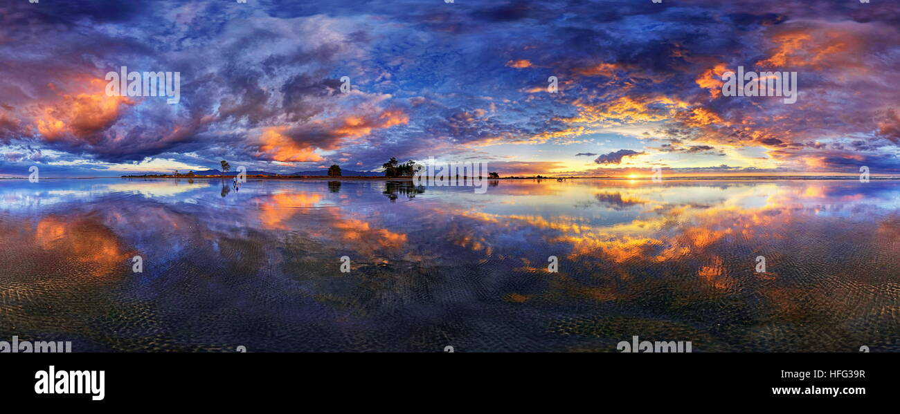 360° x 170° panorama with glorious sunset at Carters Beach, cloudy sky, Water Reflection, Westport, West - Stock Image