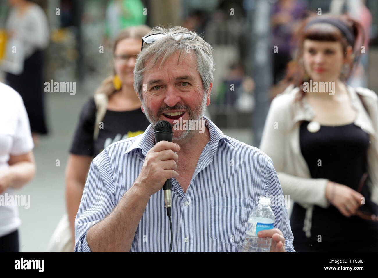 Associate professor John Minns speaking to a refugee rights rally in Canberra, Australia. - Stock Image