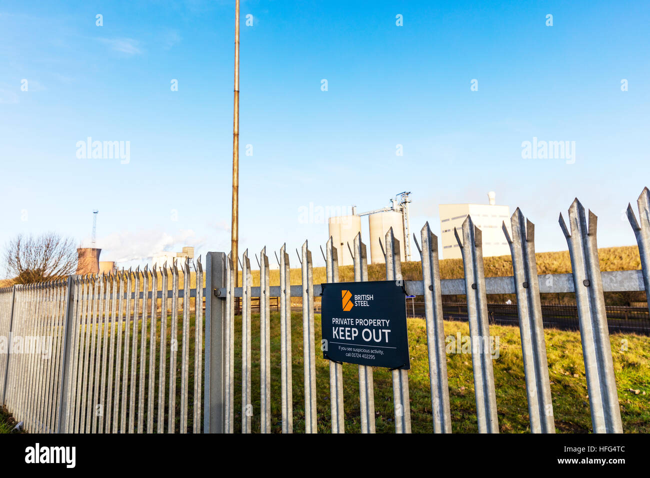British steel Scunthorpe, Scunthorpe steelworks keep out sign on fence in town in North Lincolnshire, England UK - Stock Image