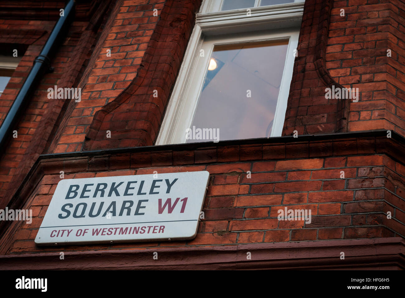 Berkeley Square road sign on the side of red brick building in Mayfair, London - Stock Image