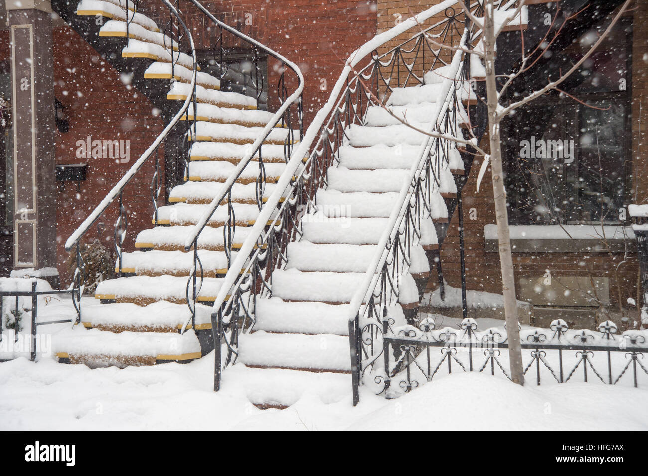 Traditional staircases covered by snow In Montreal - Stock Image