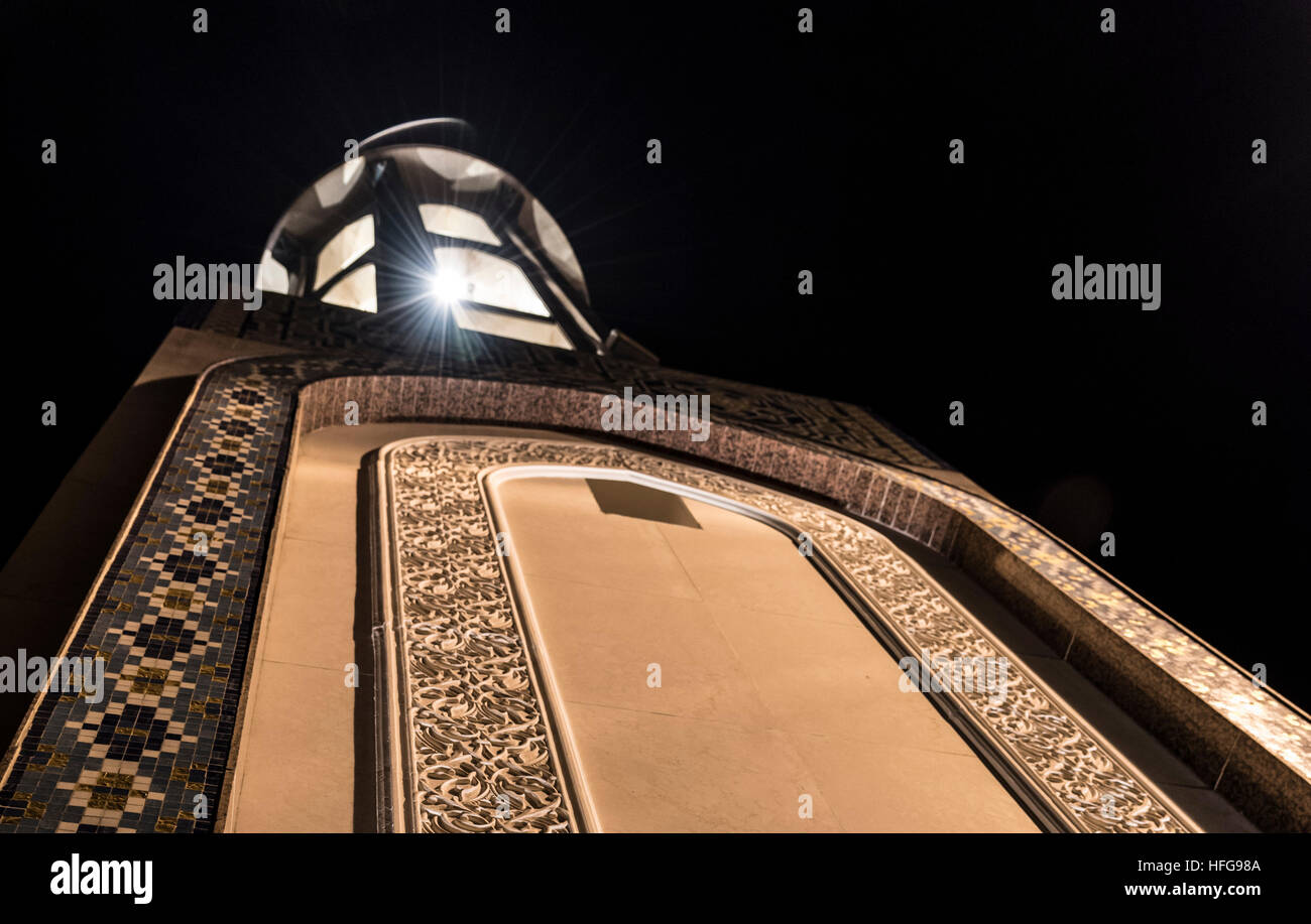 Tower of Al Alam Mosque, next to Sultan's Palace. A nice sunstar is visible, as well as some carefully crafted - Stock Image