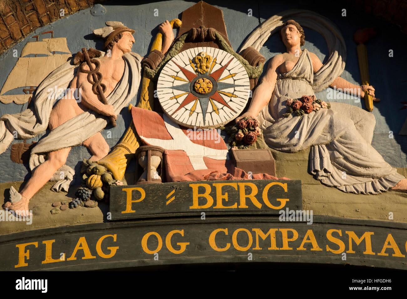 Denmark, Copenhagen, Nyhavn, P Berg, Sail, Flag and Compass Maker restored 1737 sign - Stock Image
