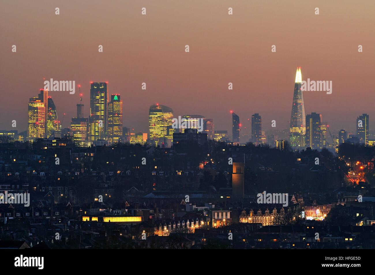 The City of London skyline at dusk, from Alexandra Palace, North London UK - Stock Image