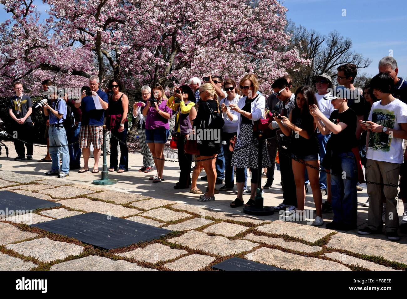 Arlington, Virginia - April 12, 2014: Tourists snapping photos at the gravesites of President John F. Kennedy, Jacqueline - Stock Image
