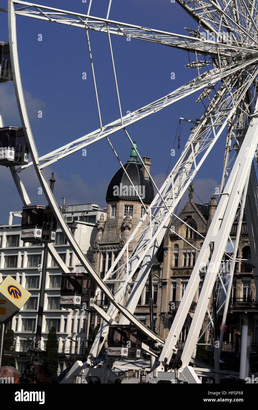 Ferris wheel of Antwerp and the architecture behind the amusement ride Stock Photo