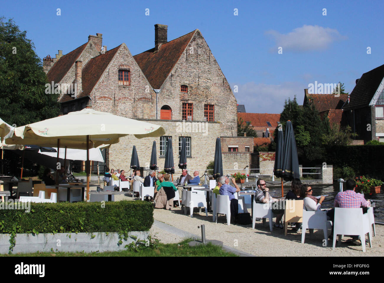 A canal-side cafe in Brugge Belgium Stock Photo