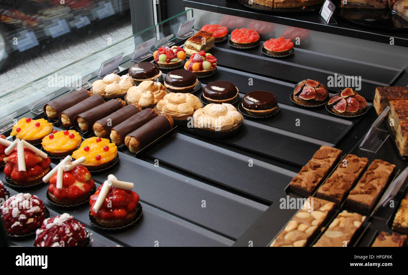 Delicious pastries await customers in a pastry shop in Brugge Bruges Belgium Stock Photo