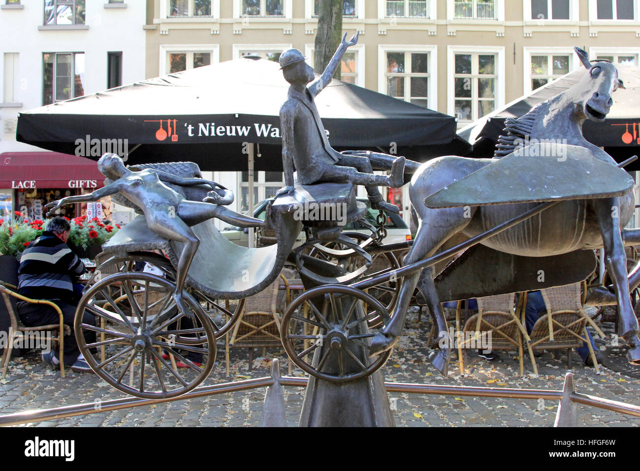 The sculpture is a modern interpretation of Zeus, Leda, Prometheus being pulled by Pegasus in Brugge Belgium by Stock Photo