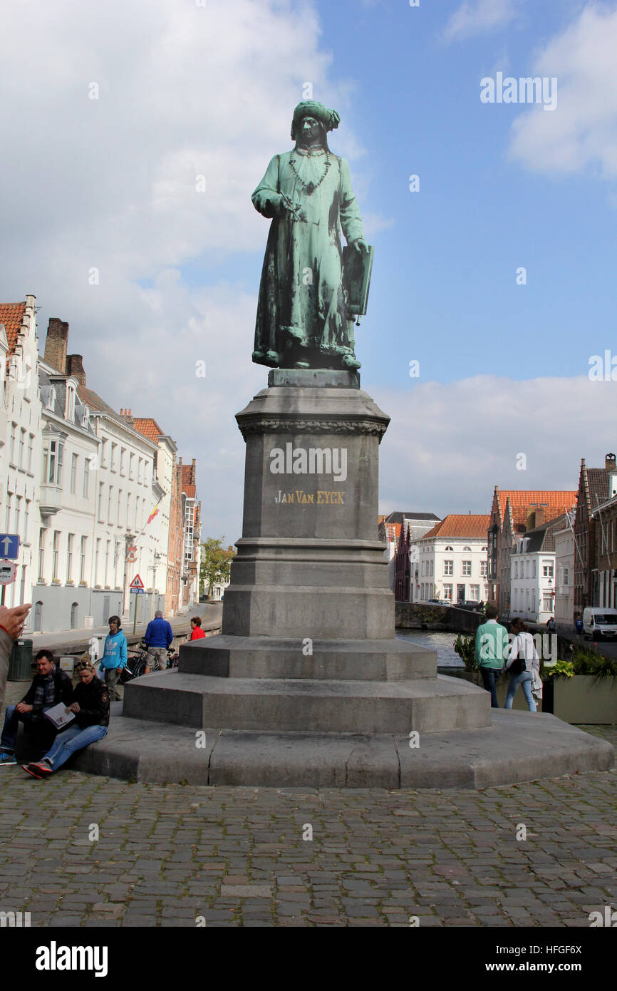 Statue of renowned Bruges painter Jan van Eyck in the plaza named after him in Bruges Belgium. Stock Photo