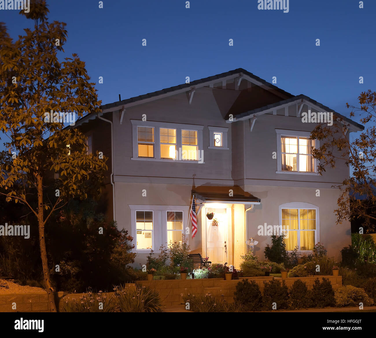 Two Story Suburban House At Night With American Flag In San Diego CA US
