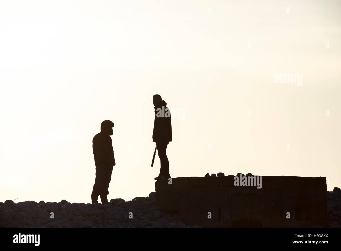 silhouette of two threatening adolescents - Stock Image