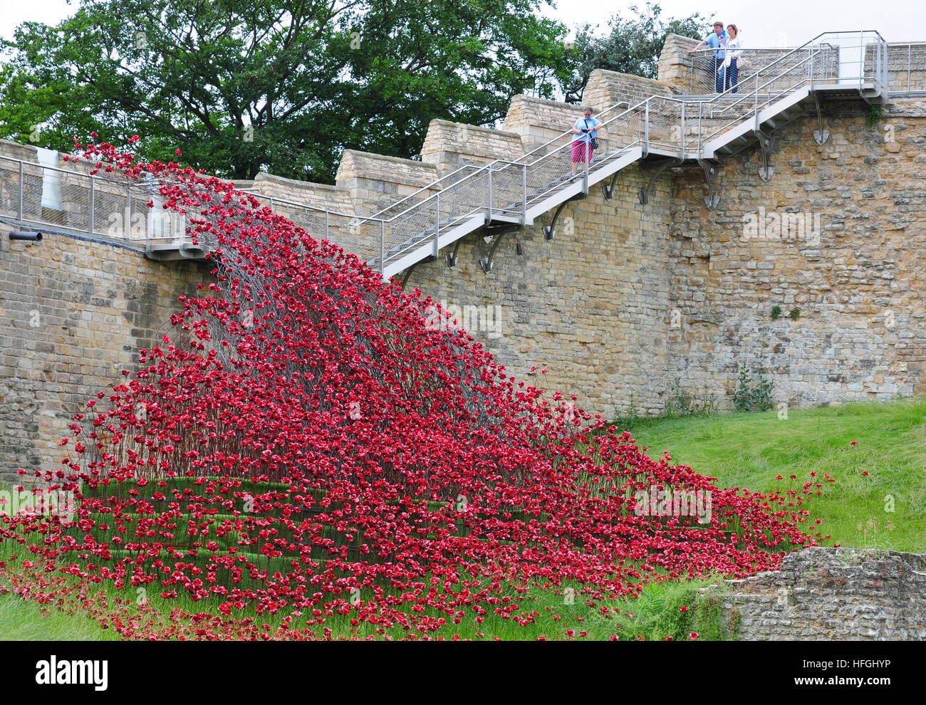 The Poppy Wave at Lincoln Castle.  Artist Paul Cummins, designer Tom Piper. At Lincoln Castle.  Castle walls. - Stock Image