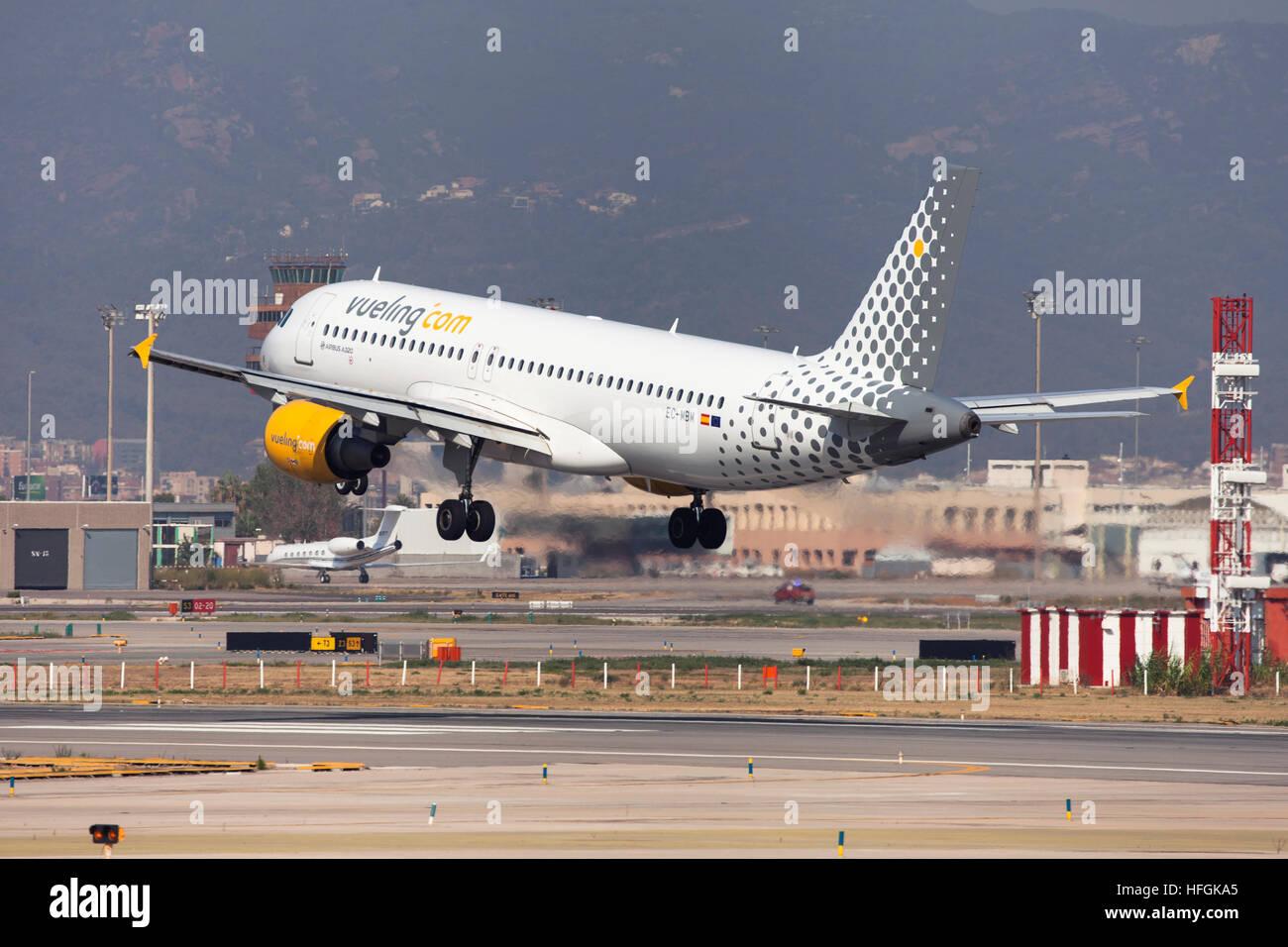Vueling Airbus A320 landing at El Prat Airport in Barcelona, Spain. - Stock Image