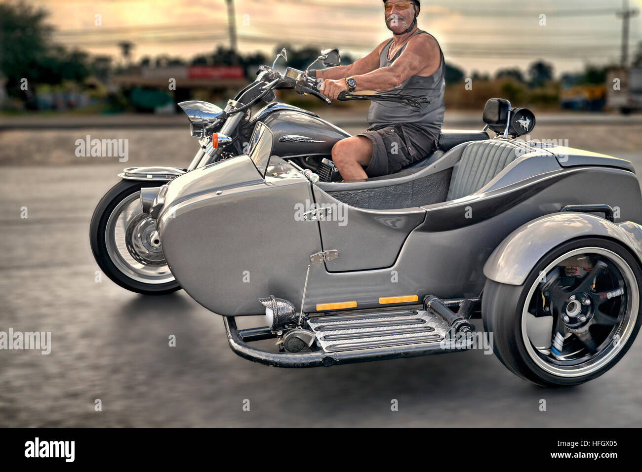 Motorcyclist riding customised motorcycle and sidecar Stock Photo