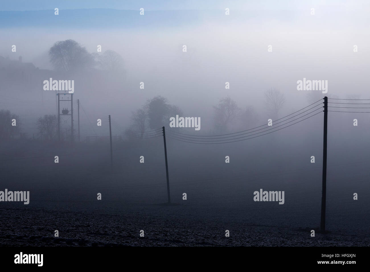 Mist and low cloud on a freezing cold December morning in North Yorkshire in the United Kingdom. - Stock Image