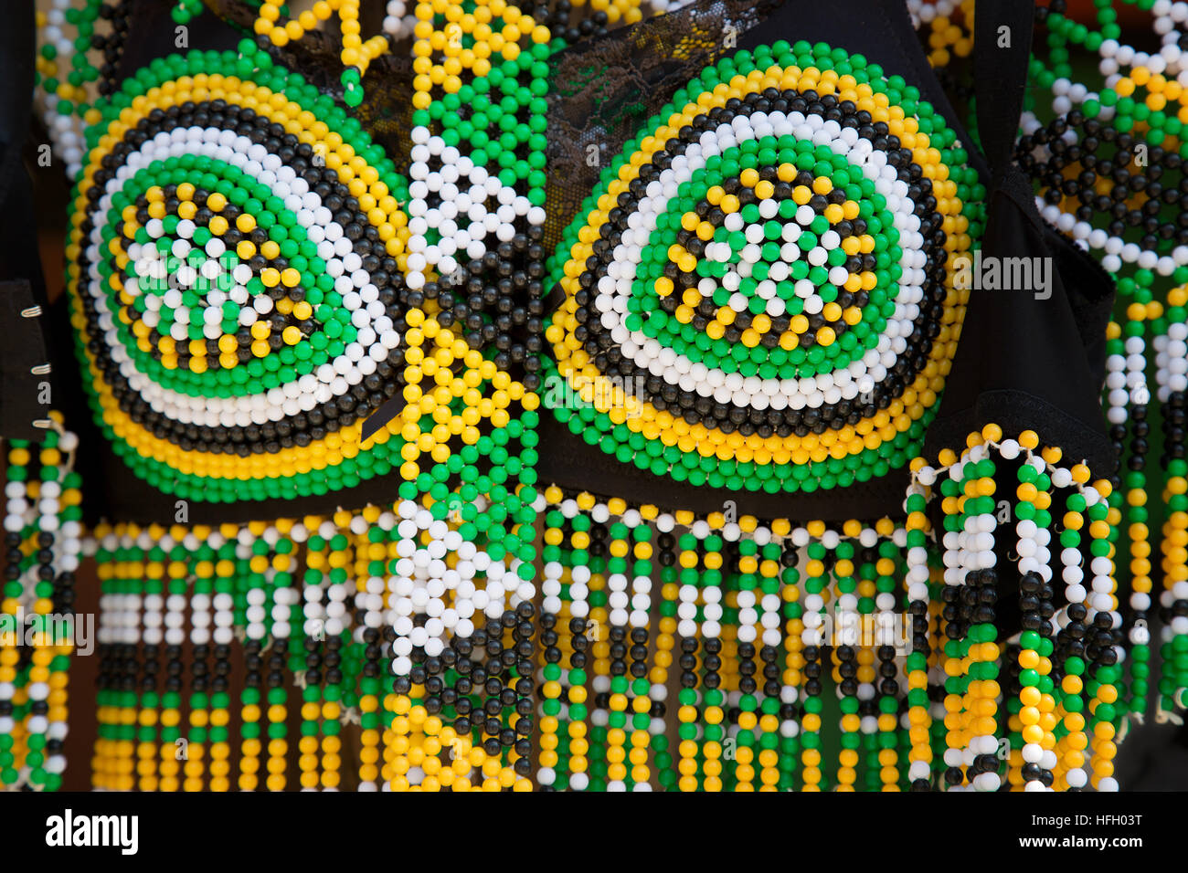 Closeup of South African tribal female dress made from bead work, for sale at a street market. - Stock Image