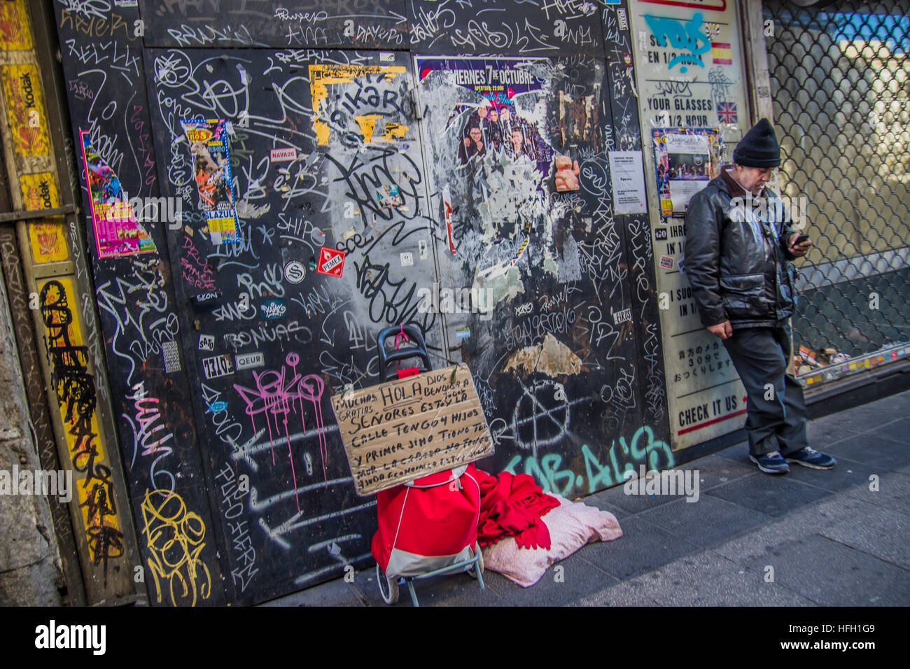 Madrid, Spain. 30th Dec, 2016. Beggars in the center of Madrid pay around 45 euros per day to the mafia to have - Stock Image