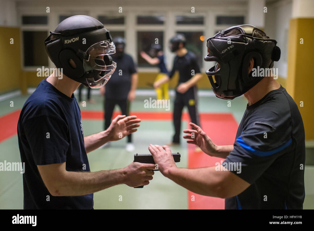 Erfurt, Germany. 27th Dec, 2016. Two participants practise with head-protection gear during a self-defence course - Stock Image