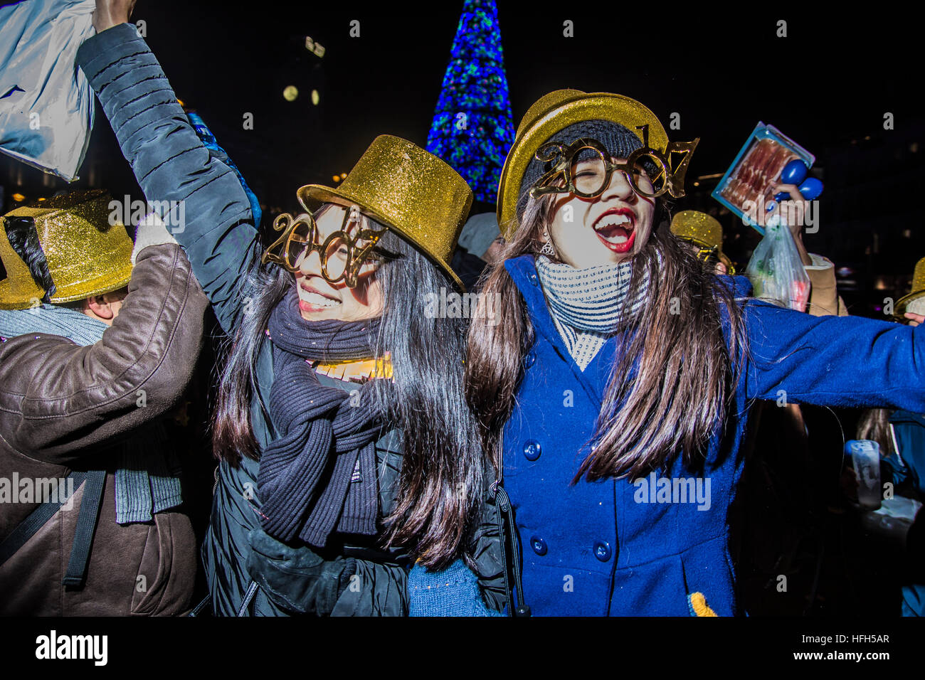 Madrid, Spain. 1st Jan, 2017. celebrations of happy new year 2017 in square sol. people in the center of Madrid - Stock Image