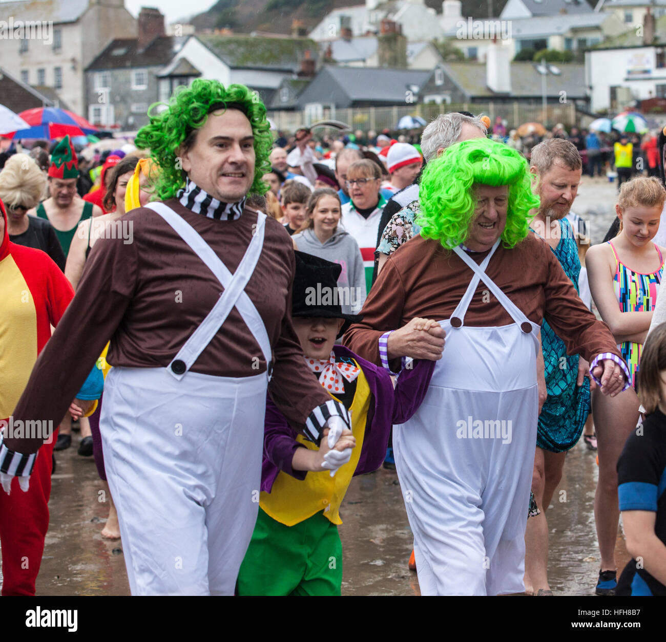 Hundreds turned out in fancy dress despite the rain to take part in the 'Lyme Lunge' - a New Year's - Stock Image