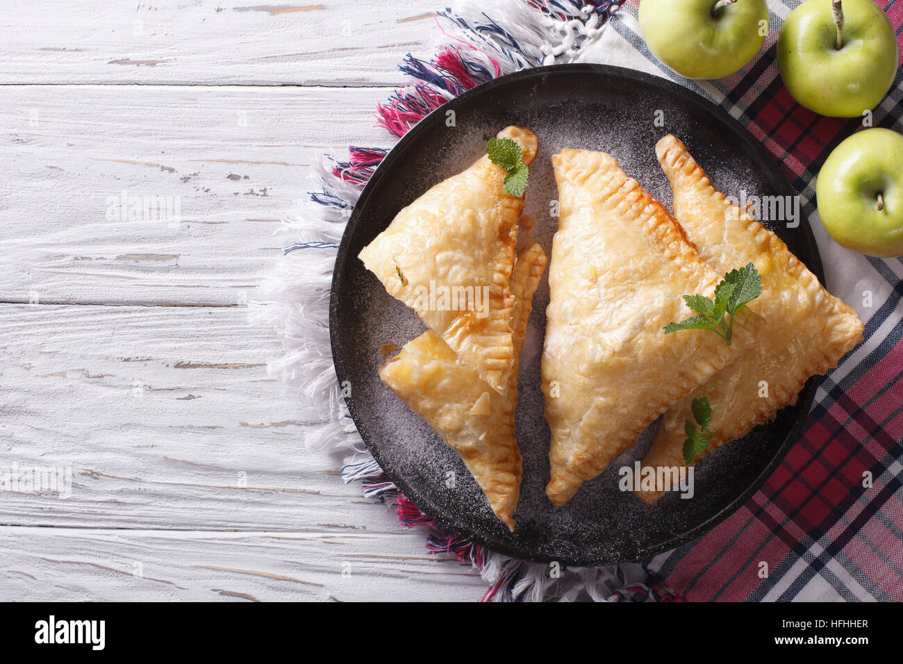 Delicious homemade apple pie turnover on a plate. horizontal view from above - Stock Image
