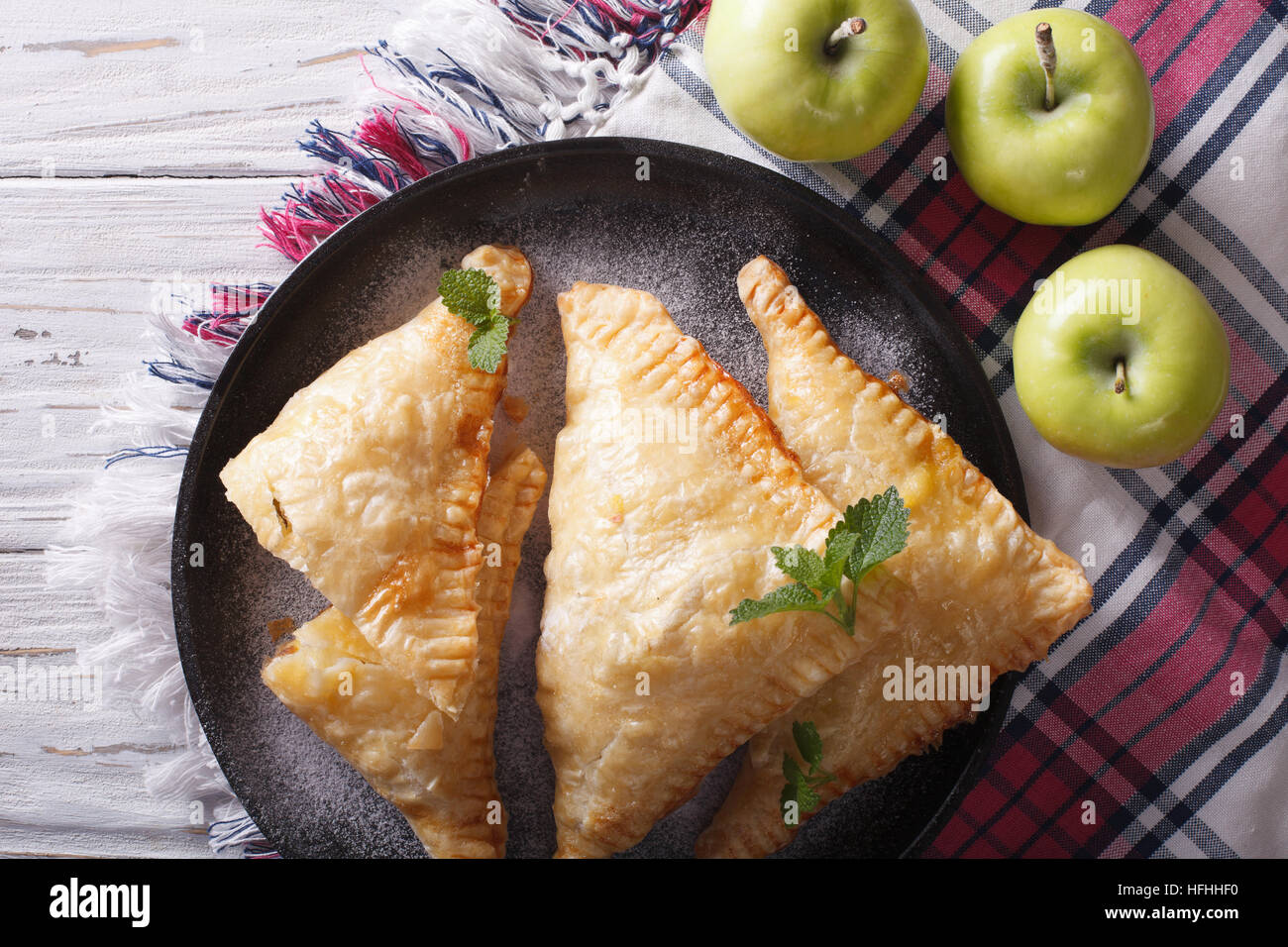 Delicious homemade apple pie turnover close-up on a plate. horizontal view from above - Stock Image