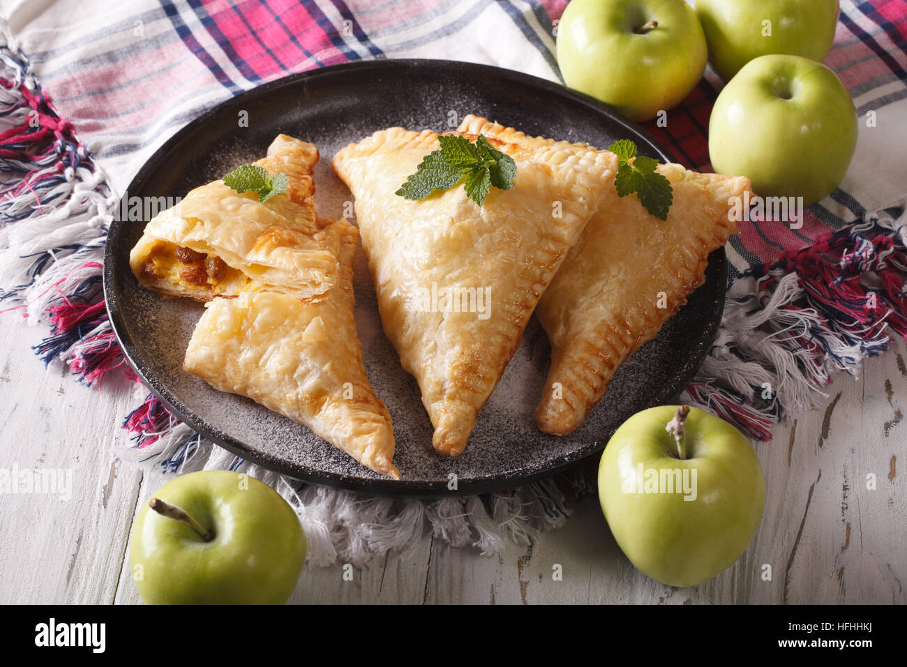 homemade turnover with apples close up on a plate. horizontal - Stock Image