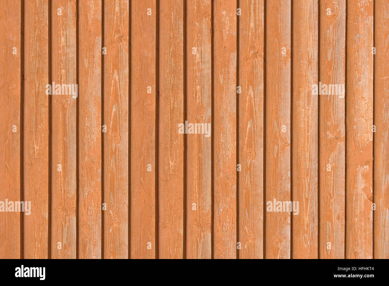 Natural old wood fence planks, wooden close board texture, overlapping light reddish brown closeboard terracotta - Stock Image