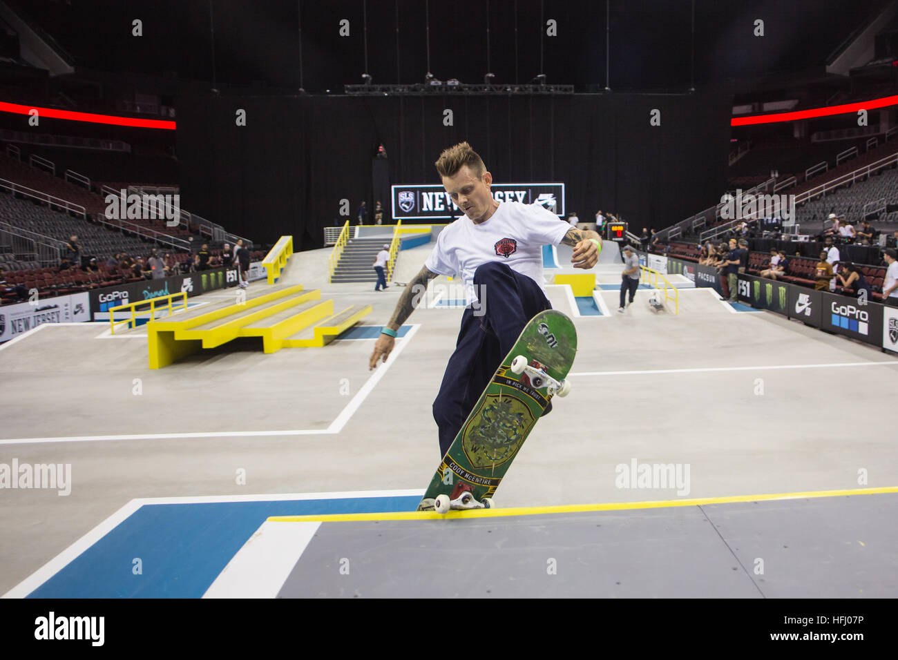 Cody McEntire nose grinds the coping during the practice session at the Street League Skateboarding contest - Stock Image