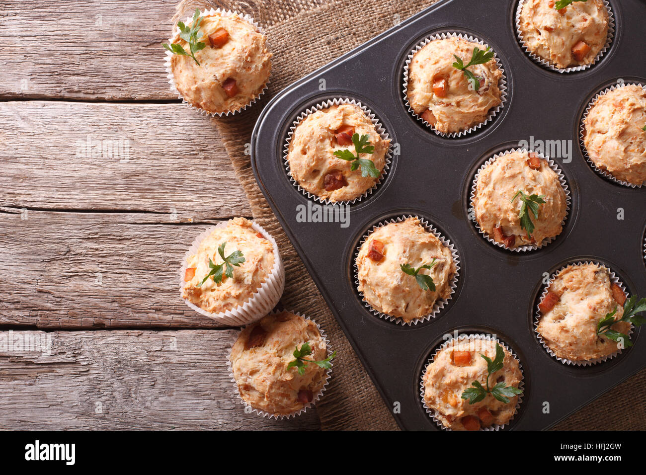 homemade muffins with ham and cheese in baking dish. horizontal top view - Stock Image