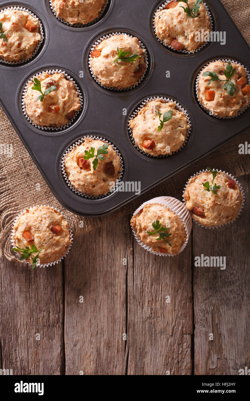 homemade muffins with ham and cheese in baking dish. vertical top view - Stock Image