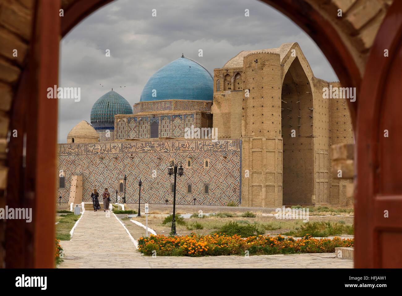 Khoja Ahmed Yasawi Mausoleum through the doors of the architectural museum Turkestan Kazakhstan - Stock Image
