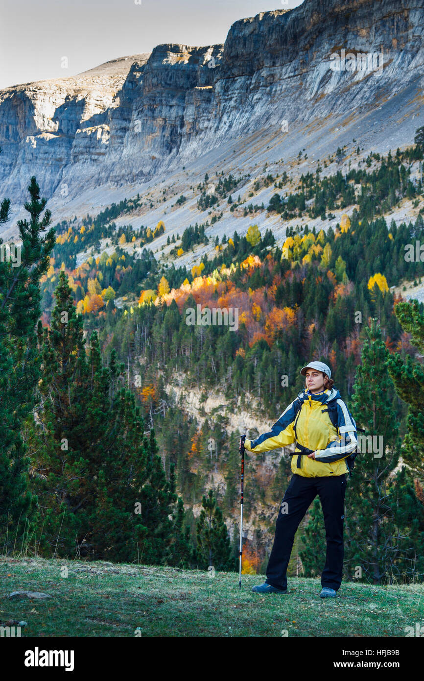 Woman and mountains view in autumn. Stock Photo