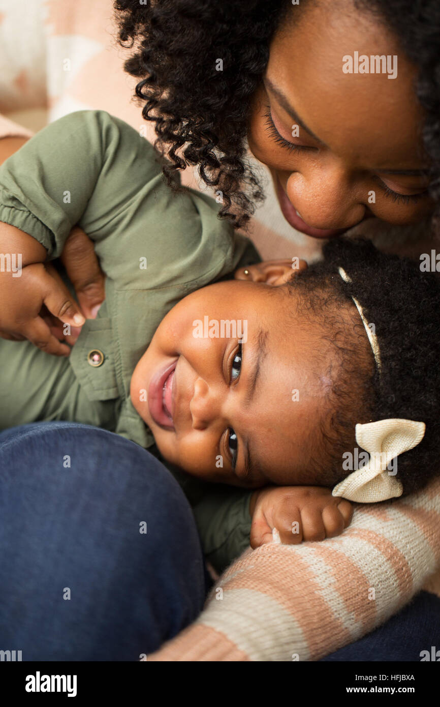 Happy African American mother and her daugher. - Stock Image