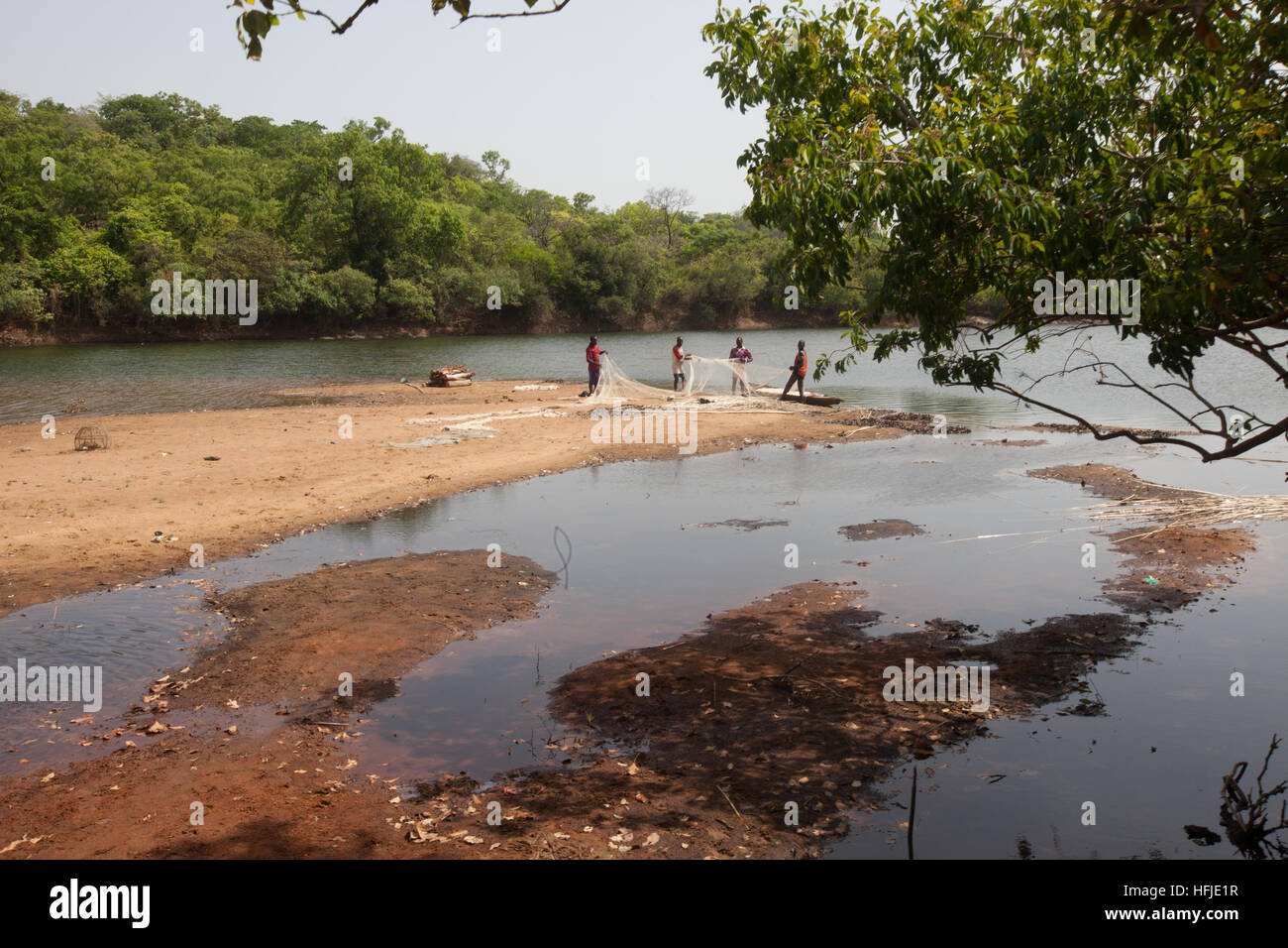 Baro village, Guinea, 1st May 2015: Fishermen prepare their nets. This time is normally good for fishing because Stock Photo