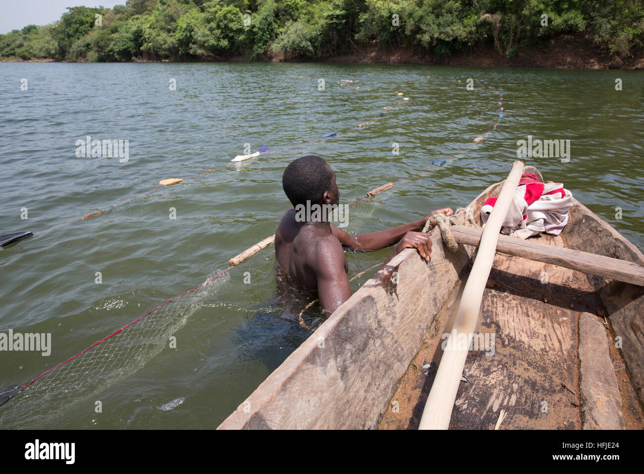 Baro village, Guinea, 1st May 2015: Fishermen move out into deeper water. This time is normally good for fishing Stock Photo