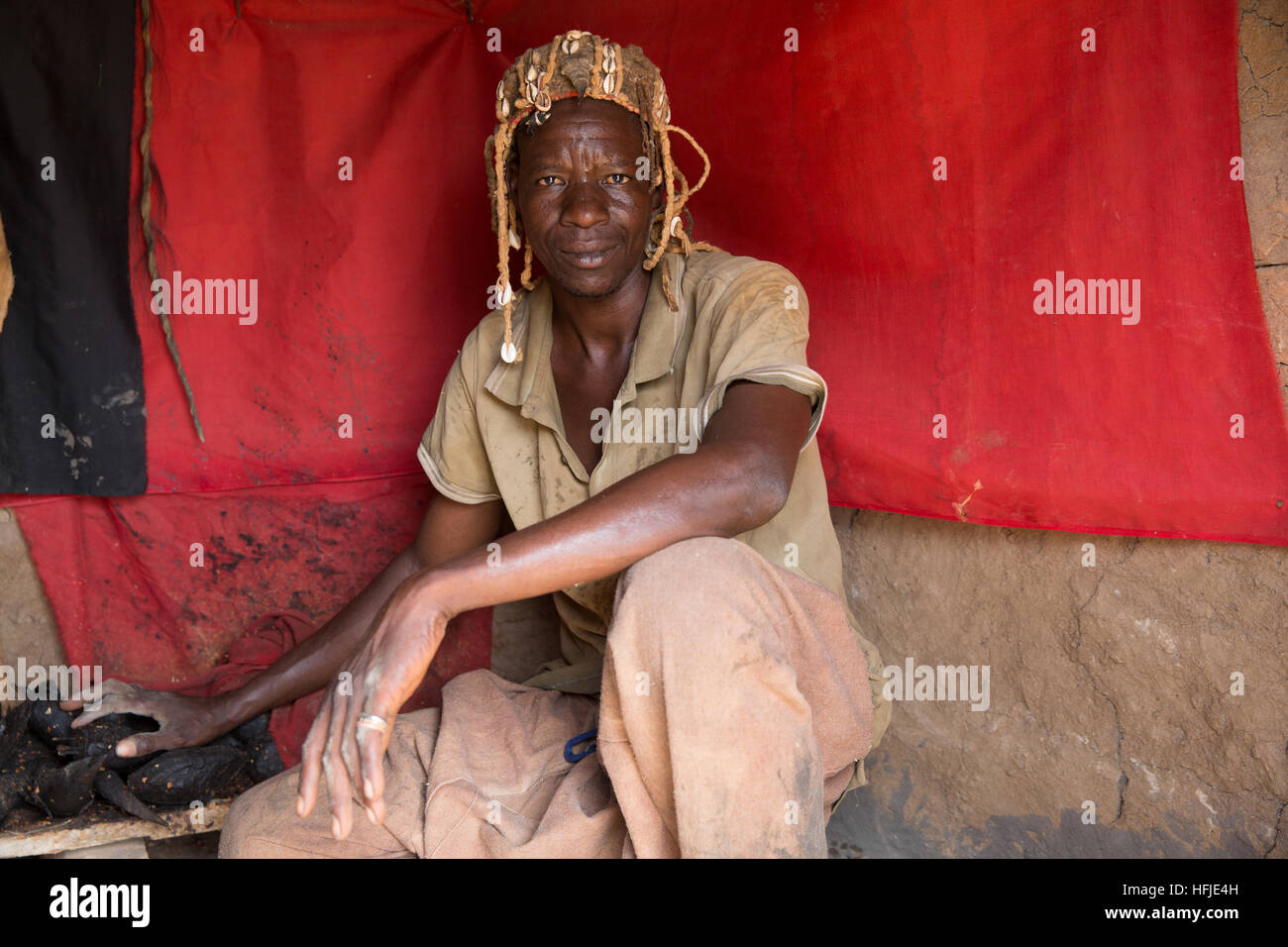 Baro village, Guinea, 1st May 2015: Layeba Kourouma, 42, farmer and traditional healer.  He treats headaches, stomach - Stock Image