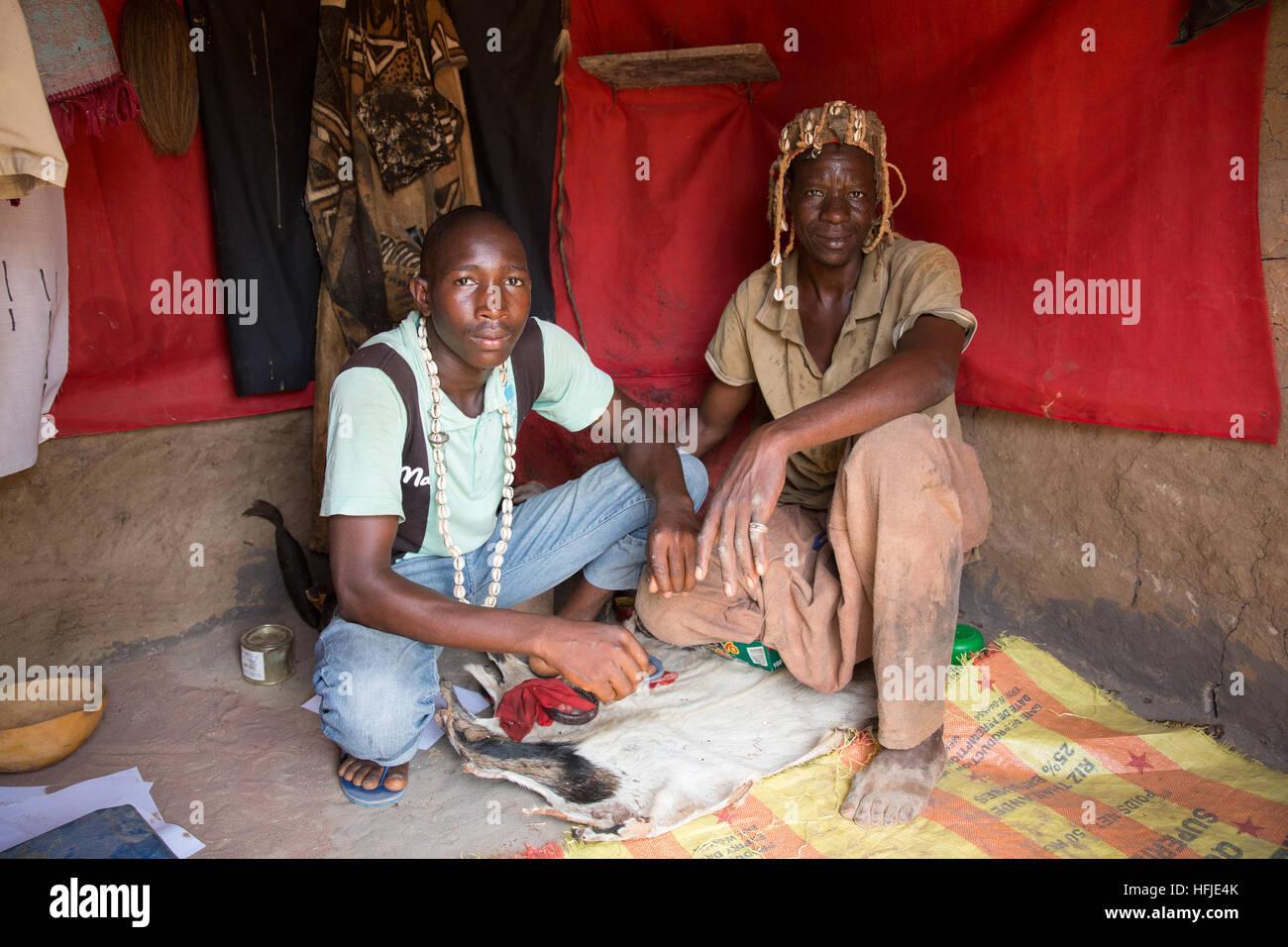 Baro village, Guinea, 1st May 2015: Layeba Kourouma, 42, farmer and traditional healer with his apprentice. He treats - Stock Image