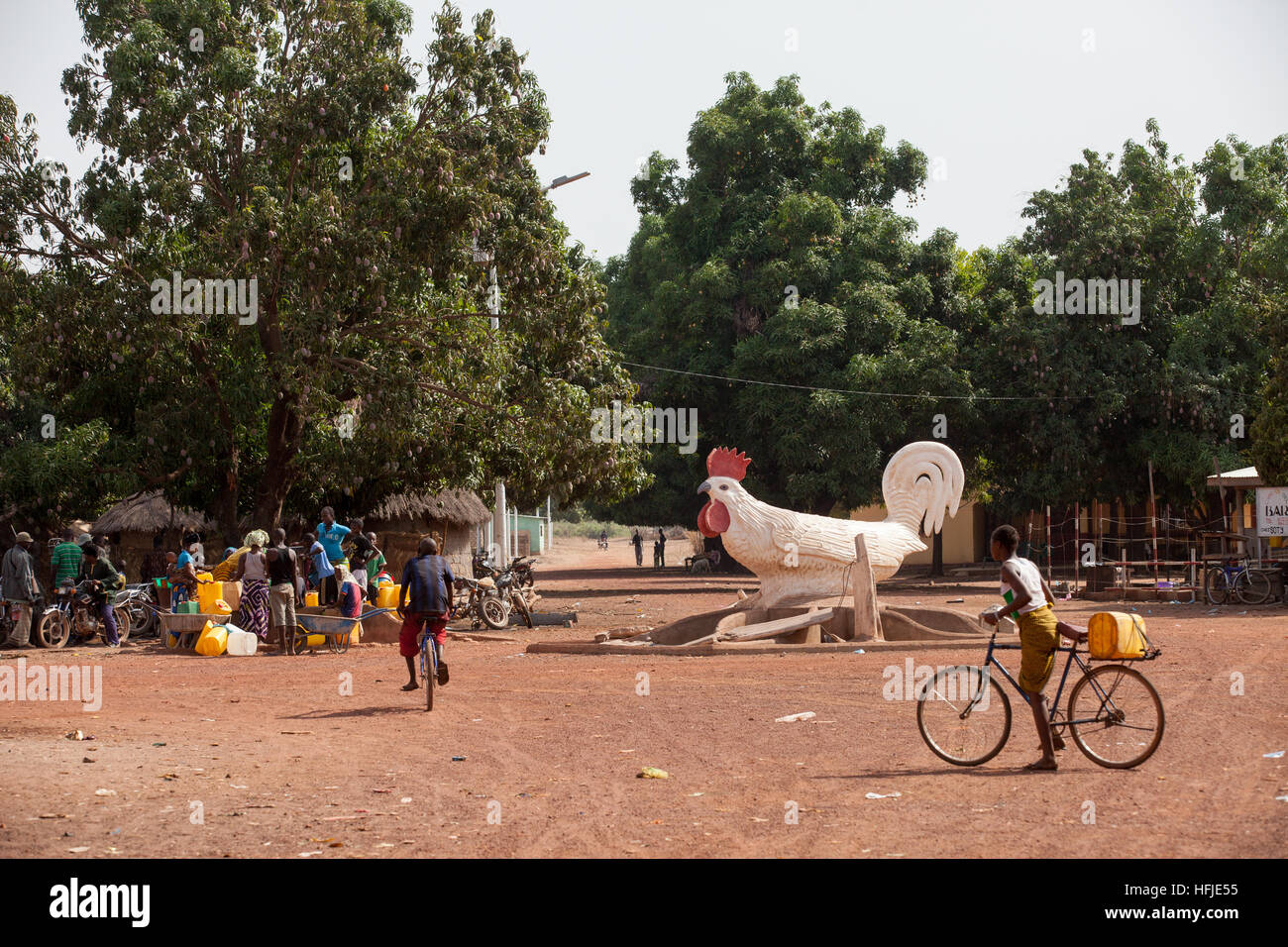 Baro village, Guinea, 1st May 2015:  People fetching water from a water point. Stock Photo