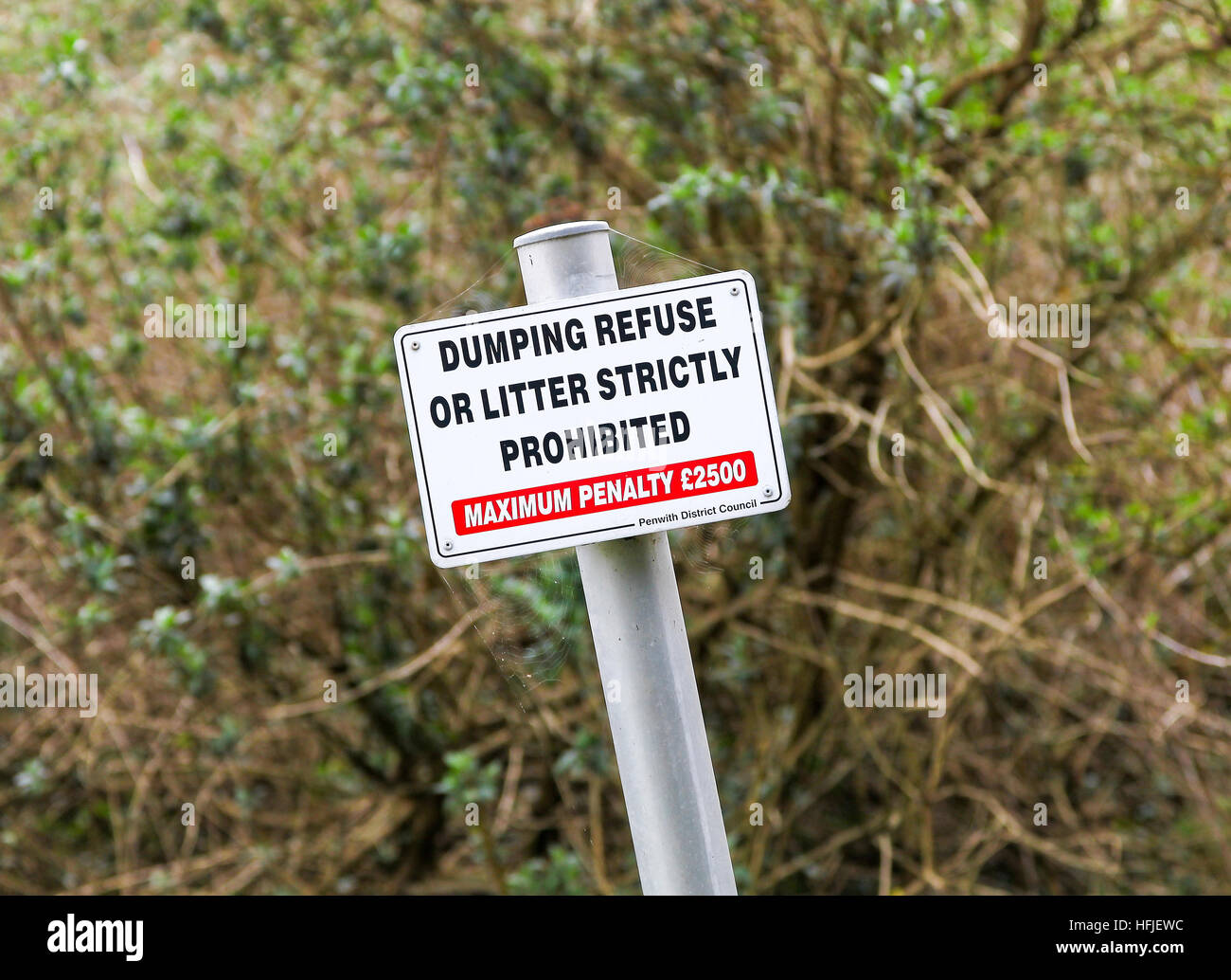 A sign post saying dumping of refuse or litter strictly prohibited, maximum penalty £2500 erected by Penwith - Stock Image